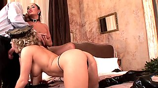 Jasmine Black and a friend take turns blowing a huge cock
