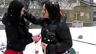 Kinky frozen gals starts fighting on the snow jamming tits and kissing