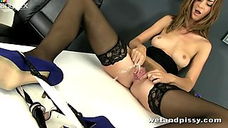 Seductive office slut Charlotte is playing with pussy on the table