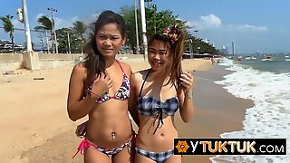Join this sexy threesome with two Asian teens and a pervert tourist after a day on the beach!