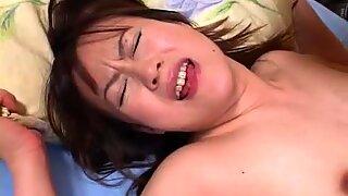 Asian babe sucks on the thumb dick and she fucks