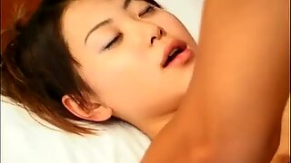 Small tits Asian bitch gets recorded as she fucks