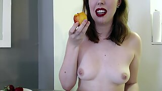 Redhead Eating Fruit Seductively Dripping on Tits and Bush