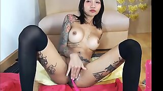 Sexy tattooed asian fucks her ass with dildo