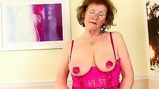 Over 60 GILF masturbates her pierced pussy