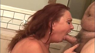 Repulsive housewife Gigi sucks the dick of fat bald headed dude in kitchen