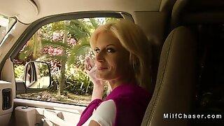 Busty Milf bangs huge cock in mini van