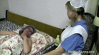 Granny and teen play pussies in bed