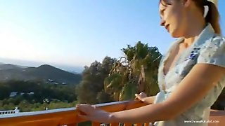 Stunning girl teasing on a terrace