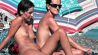 Beach voyeur enjoys the perfect body and bronze skin of a  hot nudist chick