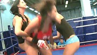 Emma Butt, Diana Stewart and Larissa Dee wrestle against each other