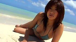 Cute redhead Japanese whore Sayaka Ando flaunts her hot body on the beach