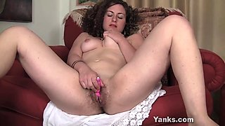 Curly haired Lara Toying Her Pussy