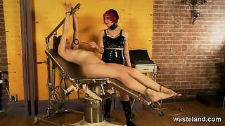 Kinky lesbian Dominatrix uses her electro wand on her pretty sex slave