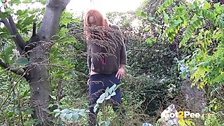 Sandy haired filthy hottie takes pleasure pissing in woods
