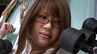 Oriental in glasses tied with rope teased with sex toys