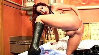 Tranny in leather boots finger fucks her asshole and jerks