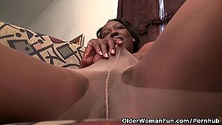 black grandmother Amanda disrobes her pantyhose and plays