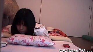 Naughty Japanese lady masturbating all alone