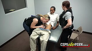 Black dude gets into the interrogatory room and gets fuck by two cops in an interracial threesome.