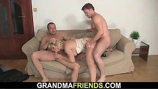 Blonde grandma enjoys fucking two cocks