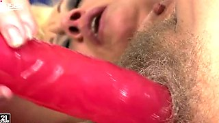 Lusty granny with hairy cunt masturbates passionately with long dildo