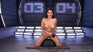 Busty beauty takes machine in the ass