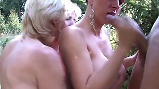 Mature ladies sharing a young guy outdoor