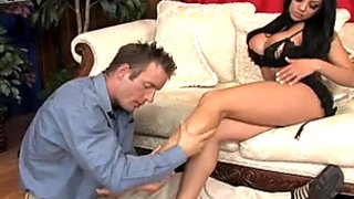 Gorgeous busty babe Audrey Bitoni gives hot footjob