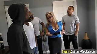 Brutal busty MILF is very happy to be surrounded by BBCs