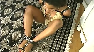 Toetied girl dials phone with feet