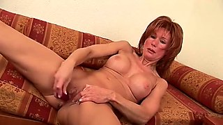 Redhead MILF playing with her new red toy