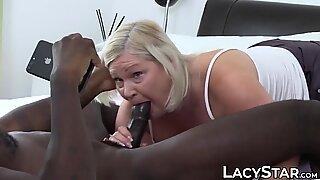 Busty GILF Lacey Starr gets cum sprayed after interracial fuck
