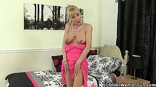 British granny Georgie Nylons fucks herself with a dildo