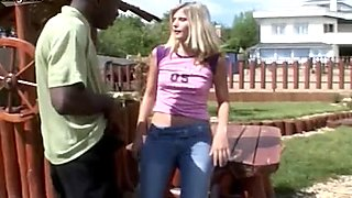 Sinful blond whore with natural tits provides black dude with blowjob