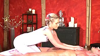 Very hot blonde masseuse gives footjob