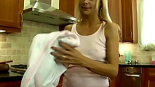 Blonde MILF teases her step-son in the kitchen