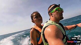 Amateur Thai girlfriend gives him a blowjob in public