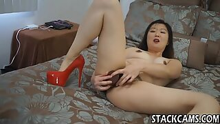 Asian in high heels masturbates