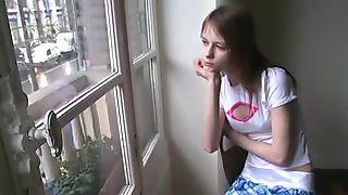 Petite teenager masturbating at window