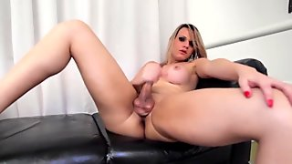 Busty shemale teasingly masturbating