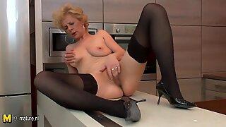 Ugly mature slut loves to masturbate in her kitchen